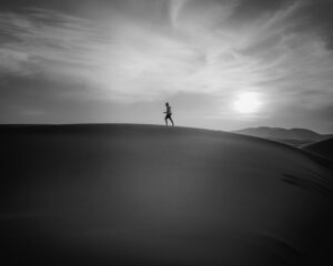 man running on sands with panic